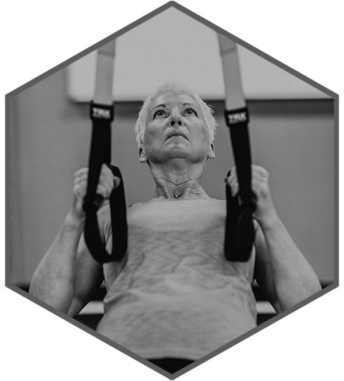 Older woman working out at Alloy
