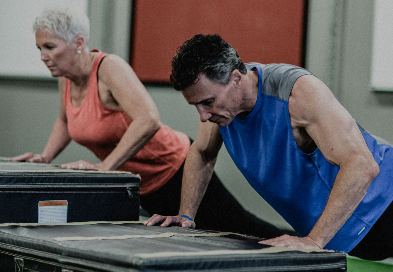 Older couple working out at Alloy
